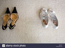 wedding shoes next a pair of chanel shoes next to a pair of white wedding shoes stock