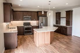 beautiful kitchen with aspect maple cabinets praline hanstone