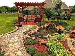 traditional landscape and yard with exterior stone floors
