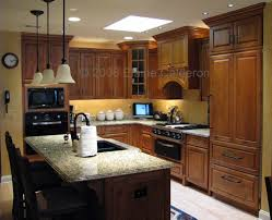 medallion gold cabinetry windwood maple door rumberry stained