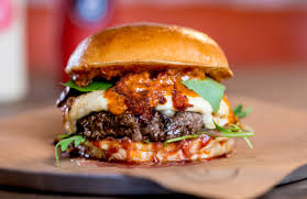the pizza burger has come to london and we need it in our bellies