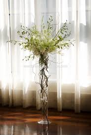 image result for flower arrangement with trumpet vase