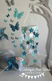 chambre bébé turquoise mobile étoiles bébé garçon turquoise caraïbe pétrole blanc bleu