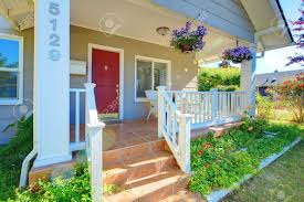 house with porch charming house with porch and flowers stock photo picture