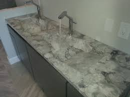 long exotic stone bathroom countertop with double though sinks of