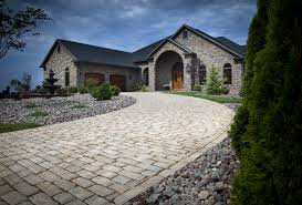 do i need to relocate downspouts for concrete or paver driveways