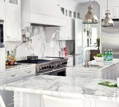 white kitchen cabinets with marble counters 16 kitchens with marble countertops that wow luxe
