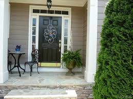 front porch home exterior design idea with front porch using round