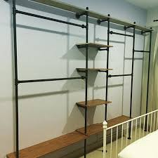 Black Pipe Shelving by Black Iron Pipe Master Closet Shelving With Tall Dress Hanging