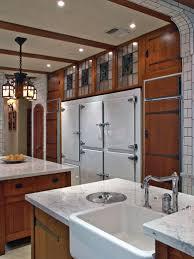 arts and crafts kitchen design craftsman style kitchen prairie cabinets brown metal mini pendant