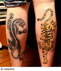 tiger and panther tattoos on back legs