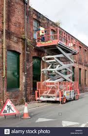 scissor st scissor lift working on the st mildreds tannery building in