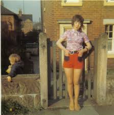 feather cut 60 s hairstyles lilac lacey top red and navy hotpants and feather cut hairstyle