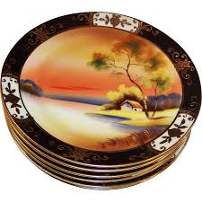 set of six 1918 gilded noritake tree in the meadow plates from