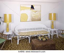 stock image of 1970s living room yellow table lamps white wicker
