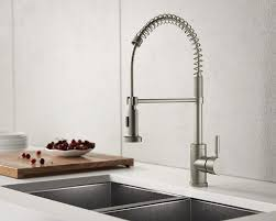 stainless steel sinks and faucets for kitchens and baths