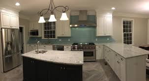 subway tile kitchen a stainless steel kitchen hood stands over a