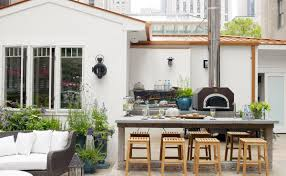 best outdoor kitchen design with stone dining table and wooden