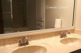 common ground framed bathroom mirror