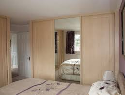 furniture bedroom with sliding mirrored wardrobe door with