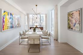 modern dining room with high ceiling hardwood floors in york