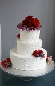 a simple cake wedding cake with fresh flowers from trader joe u0027s