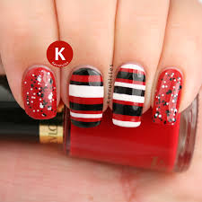 red black and white stripes and glitter nail art by claire kerr