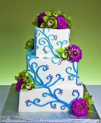 bright and bold summer wedding cakes tea green chandelier