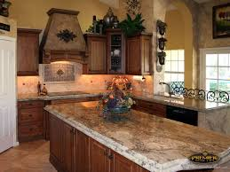 mediterranean kitchen with kitchen island by premier kitchen and