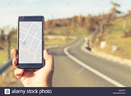 Gps Map Hand Holding Smartphone With Gps Map On Autumn Outdoor Background
