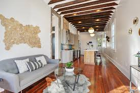 this vibrant cottage in bywater hits market at 335k