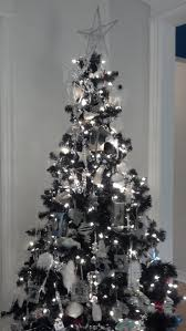 white christmas tree with silver and red decorations