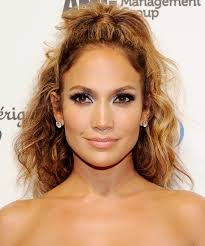 boy wears his hair in an updo 13 party hairstyles for curly hair instyle com