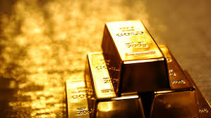 gold settles lower as the dollar slumps in black friday trade