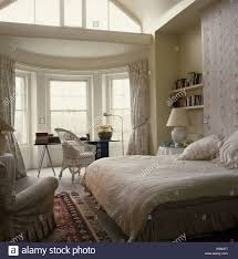 Bedroom Bay Window Furniture Desk And Chair In Bay Window Of Neutral Bedroom With Alcove