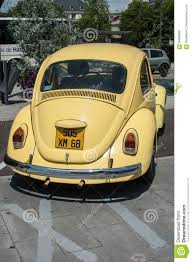 yellow volkswagen beetle royalty free old volkswagen yellow beetle parked in the street editorial stock
