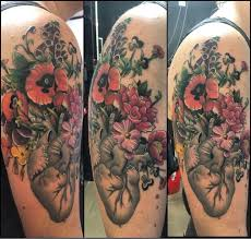 image result for anatomical heart tattoo with flowers tats