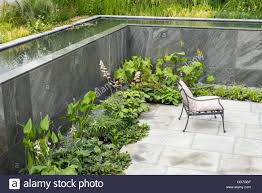 paved sunken garden with flowing water pool cascading water walls