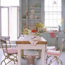 shabby chic dining room with vintage furniture and pastel wall