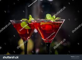 raspberry martini two martini glasses red alcohol raspberry stock photo 514536928