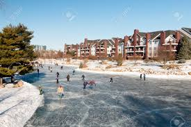 Backyard Ice Rink Plans by Winter Fun On An Outdoor Ice Skating Rink Minnesota Usa Stock