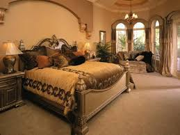 wonderful chandelier above luxury queen size beds master bedroom