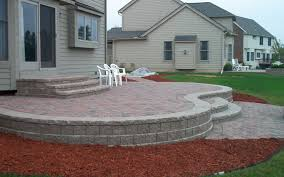 Unilock Patio Designs by Mountain Style Concrete Paver Patio Photo In Raleigh With A Fire