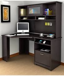 black wooden corner desk with drawers and shelves on brown rug