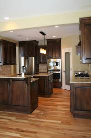 wood countertops dark kitchen cabinets with floors lighting