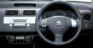 Toyota Platz Interior Head To Head Toyota Vitz Vs Suzuki Swift Carmudi Pakistan