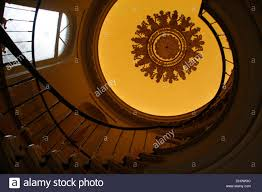 ornamental plaster ceiling above a staircase in a hotel bruges