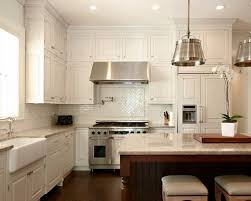 great white kitchen cabinets with backsplash in countertops