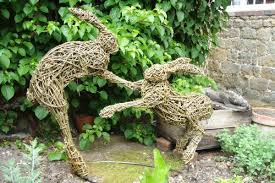 sculpture by sculptor walker titled boxing hares 2