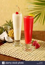 daiquiri cocktail a pina colada and strawberry daiquiri cocktail stock photo